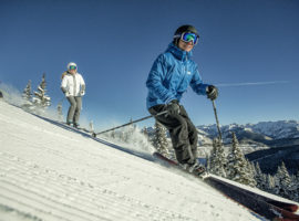 A group of friends skiing groomed terrain on Vail Mountain.
