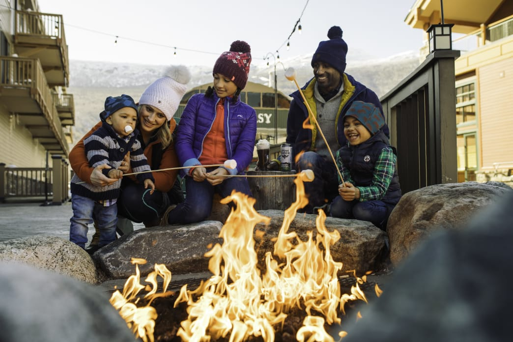 Family making s'mores at mountain resort