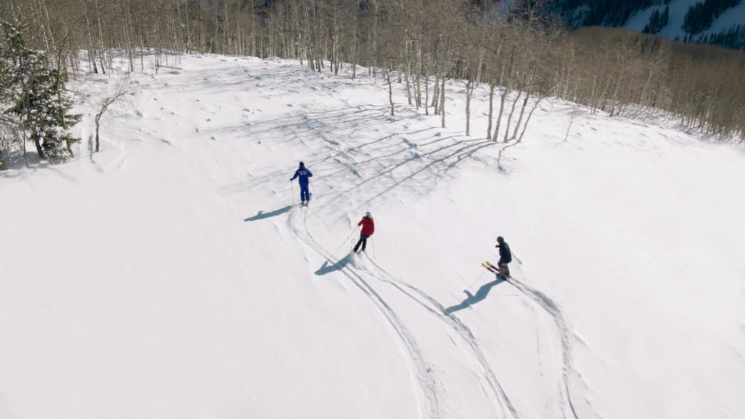 Skiers going down the slope